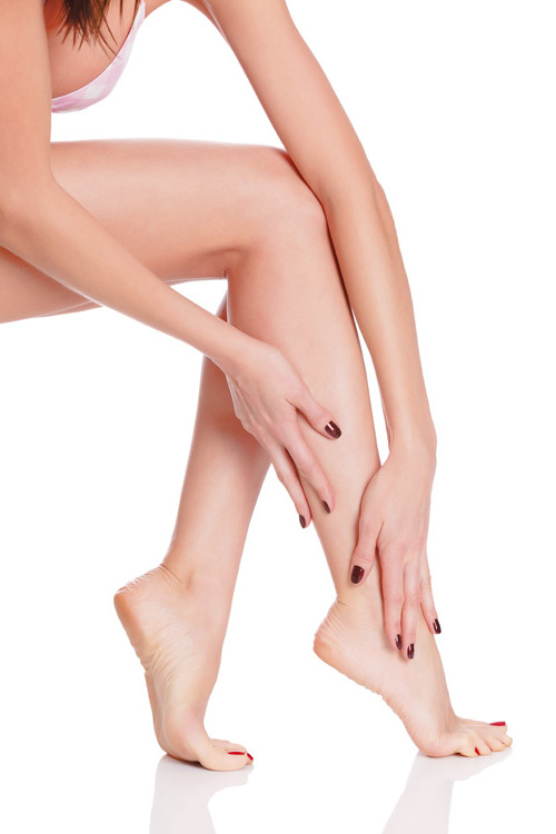 After depilation.  Perfect long female legs against white background